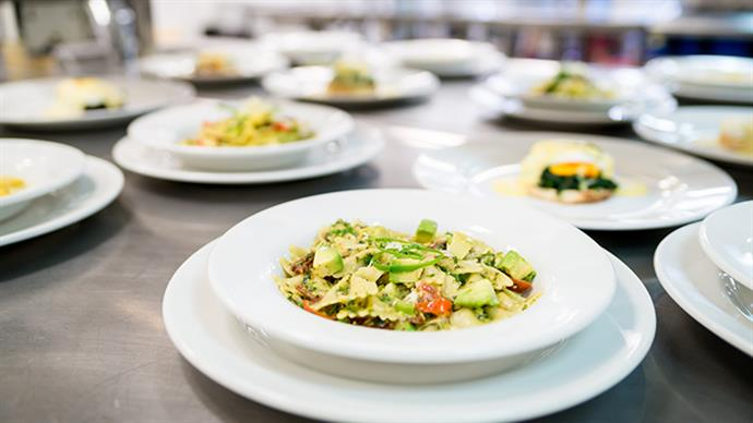Restaurant meals plated up in a commercial kitchen